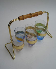SIX 1960S COLOURED SHOT GLASSES IN STAND