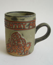 1960s TREMAR STUDIO POTTERY COUNTRY MUG WITH RAISED BUTTERFLY  DESIGN