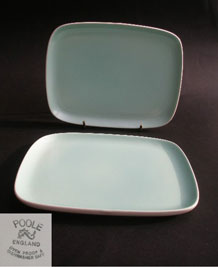 PAIR OF POOLE TWINTONE ICE GREEN AND MAGNOLIA RECTANGULAR PLATES